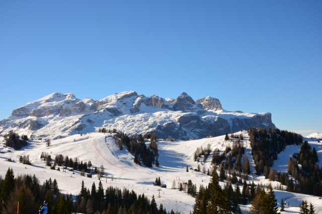 The Alta Badia Ski area, with Gruppo Sella and Sassongher mountains as backdrop.